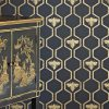 Barneby Gates honeybees gold on charcoal wallpaper